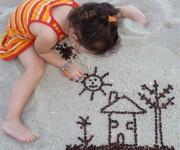 На пясъка :)